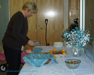 Kathleen preparing the table