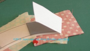 Fold back pattern and prepare to trim seam allowance