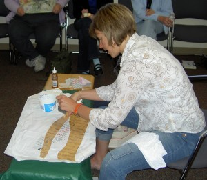 Sue applying paper to fabric