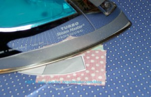 Press first sewn pieces