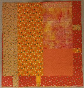 Orange Strip Donation Quilt back