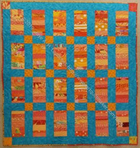 Orange Strip Donation Quilt