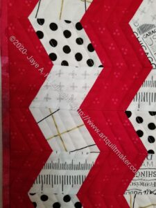 Red Text Table Runner quilting detail