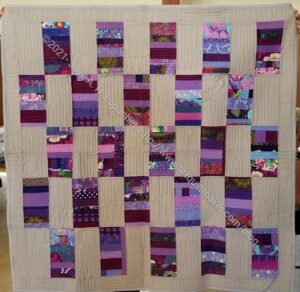 Purple Strip Donation Quilt Finished
