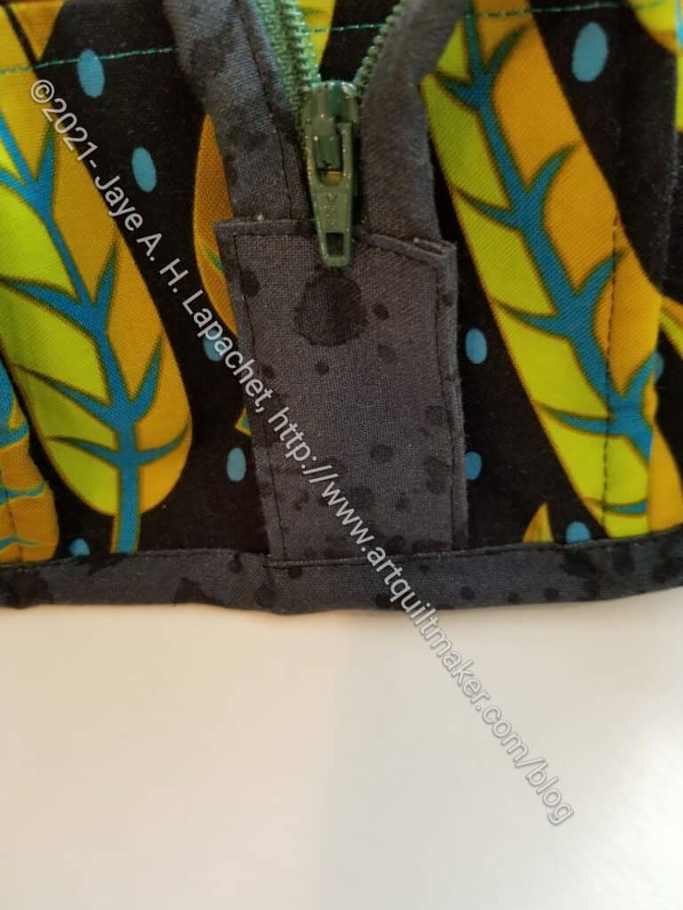 Zipper tabs sewn into binding - finished