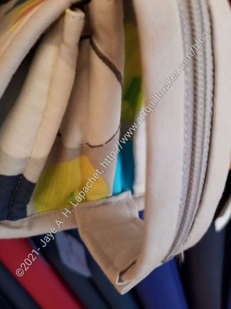 Grey zipper tab ends